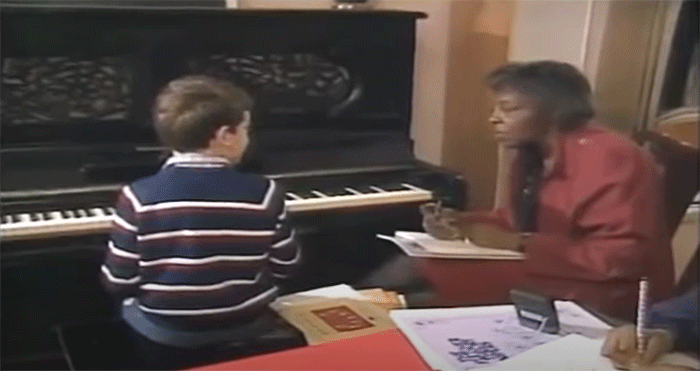 Dr. Daisy Peterson Sweeney giving music and piano lessons to students.